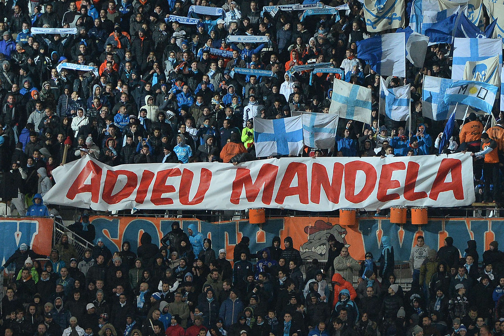 ". Marseille\'s football club supporters hold a banner reading ""Farewell Mandela\"" before the start of the French L1 football match Olympique of Marseille (OM) versus Nantes (FCNA) at the Velodrome stadium in Marseille, southern France, on December 06, 2013, a day after the death of former South African President Nelson Mandela.  AFP PHOTO / BORIS HORVAT/AFP/Getty Images"