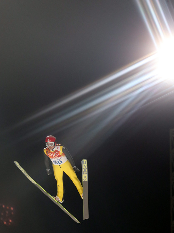 . Simon Ammann of Switzerland in action during a trial jump in RusSki Gorki Jumping Center at the Sochi 2014 Olympic Games, Krasnaya Polyana, Russia, 14 February 2014.  EPA/GRZEGORZ MOMOT