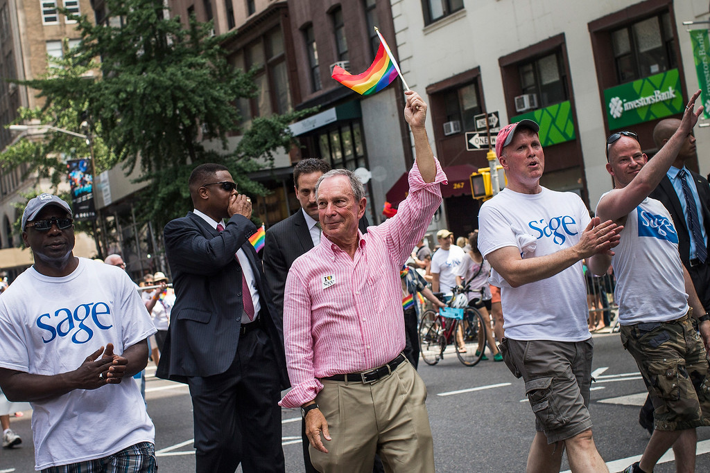 . NEW YORK, NY - JUNE 30:  New York City Mayor Michael Bloomberg waves to revelers while marching in the New York Gay Pride Parade on June 30, 2013 in New York City.  This year\'s parade was a particularly festive occasion, due to the recent Supreme Court Ruling that it was unconstitutional to ban gay marriage.  (Photo by Andrew Burton/Getty Images)