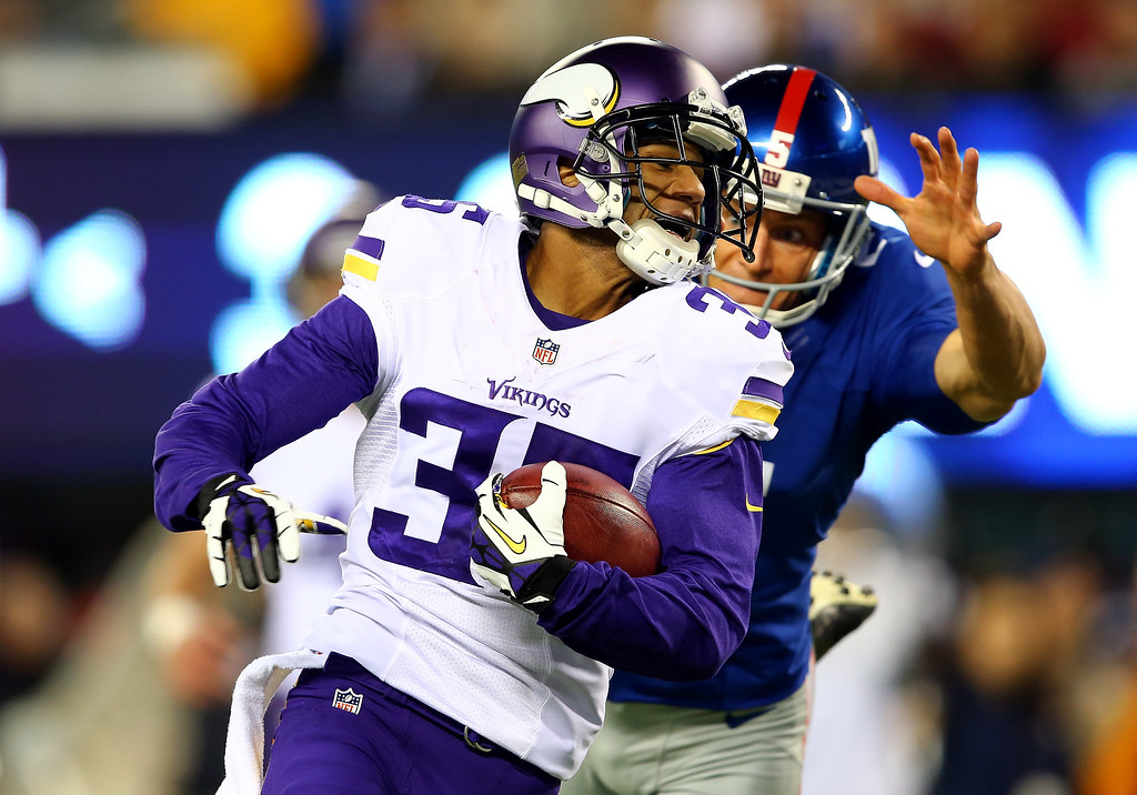 . Cornerback Marcus Sherels #35 of the Minnesota Vikings returns a punt for a touchdown in the first quarter as punter Steve Weatherford #5 of the New York Giants tries to make the tackle during a game at MetLife Stadium on October 21, 2013 in East Rutherford, New Jersey.  (Photo by Elsa/Getty Images)