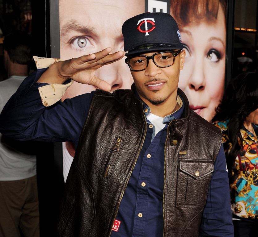 ". Actor/rapper T.I. arrives at the premiere of Universal Pictures\' ""Identity Theft\"" at the Village Theatre on February 4, 2013 in Los Angeles, California.  (Photo by Kevin Winter/Getty Images)"