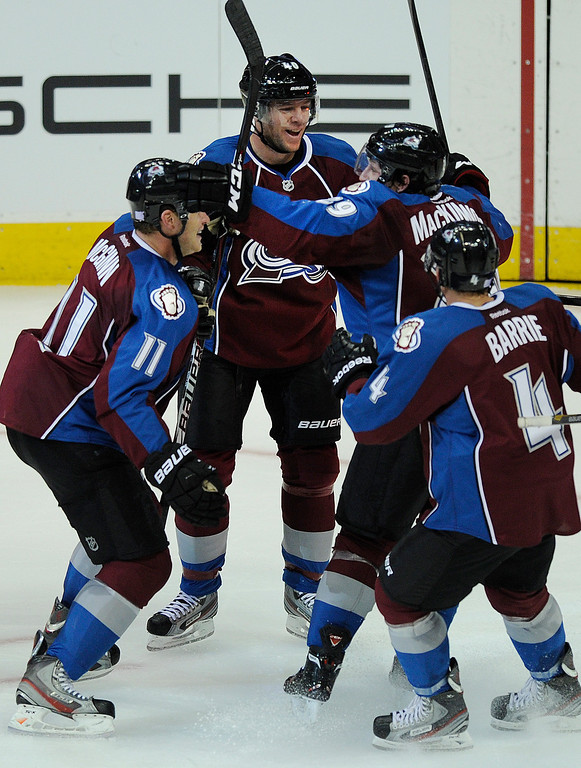 . DENVER, CO. - OCTOBER 02: Colorado rookie Nathan MacKinnon (29) jumped into the arms of wing Jamie McGinn (11) after MacKinnon fed him for a goal in the second period. It was MacKinnon\'s first NHL point. The Colorado Avalanche hosted the Anaheim Ducks at the Pepsi Center Wednesday night, October 2, 2013. Photo By Karl Gehring/The Denver Post