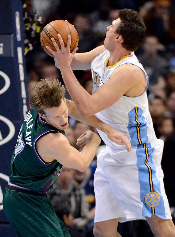 . DENVER, CO. - FEBRUARY 05: Mike Dunleavy (17) of the Milwaukee Bucks gets hit in the face by Danilo Gallinari (8) of the Denver Nuggets during the fourth quarter February 05, 2013 at Pepsi Center. The Denver Nuggets defeated the  Milwaukee Bucks 112-104 in NBA action. (Photo By John Leyba/The Denver Post)