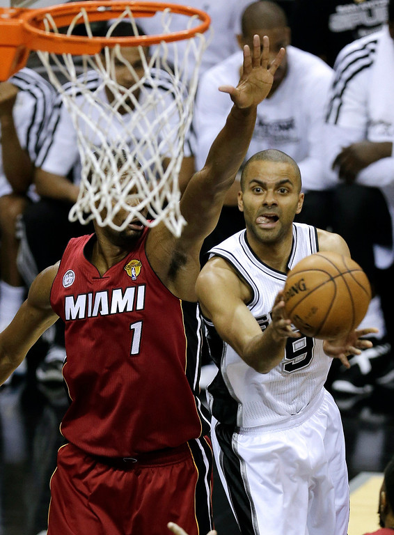 . San Antonio Spurs\' Tony Parker (9) shoots against Miami Heat\'s Chris Bosh (1) during the first half of Game 3 in their NBA Finals basketball series, Tuesday, June 11, 2013, in San Antonio. (AP Photo/David J. Phillip)