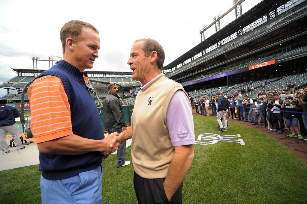 . DENVER, CO. - MAY 07: Denver Broncos Peyton Manning shakes hands with ,Dick Monfort duirng the Colorado Rockies New York Yankees batting practice  May 7, 2013 at Coors Field. (Photo By John Leyba/The Denver Post)