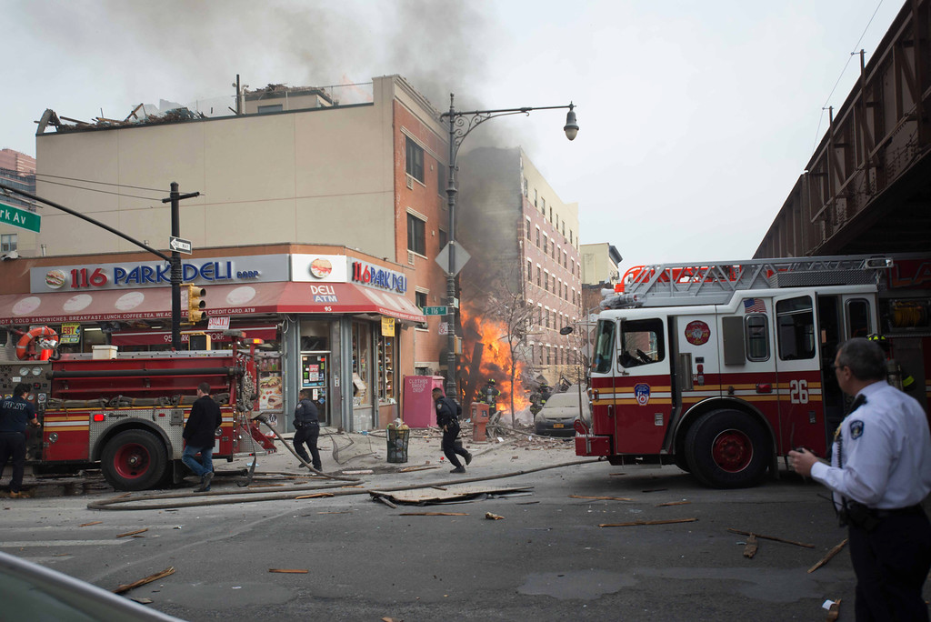 . Emergency crews respond to an explosion and building collapse in the East Harlem neighborhood of New York, Wednesday, March 12, 2014. The explosion leveled an apartment building, and sent flames and billowing black smoke above the skyline. (AP Photo/Jeremy Sailing)