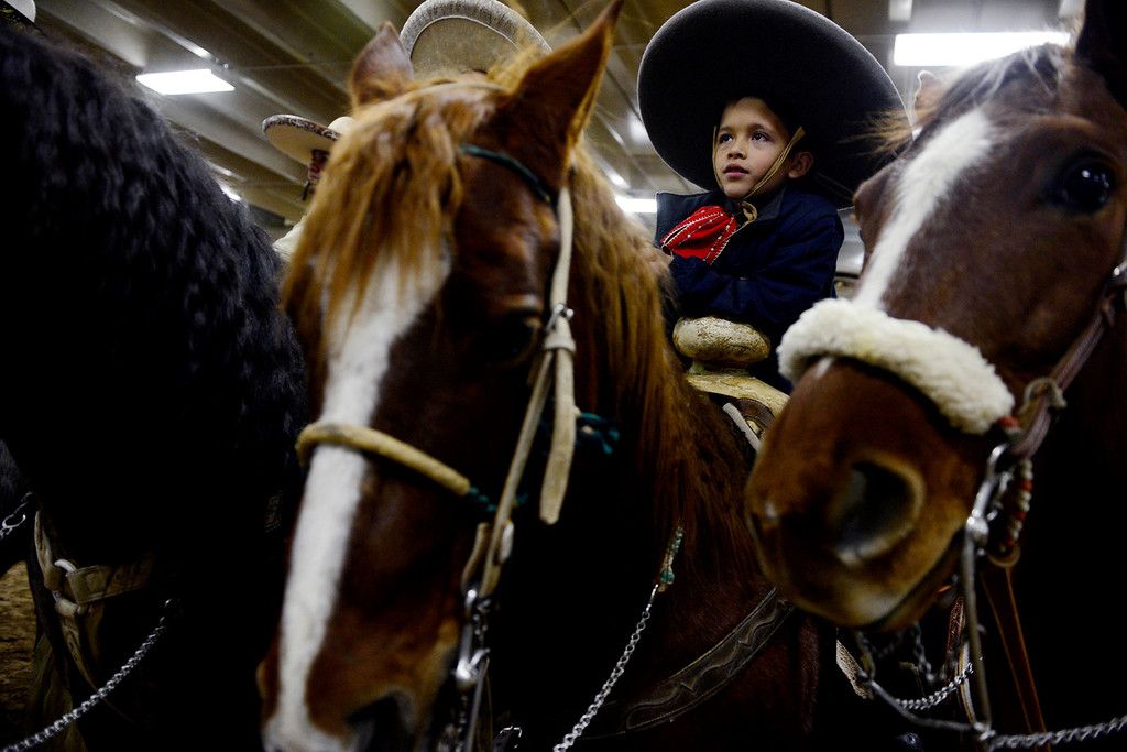 . Luis Madera, 8, sit atop his horse during National Western Stock Show\'s Mexican Rodeo Extravaganza at the Denver Coliseum on Sunday, Jan. 13, 2013. AAron Ontiveroz, The Denver Post