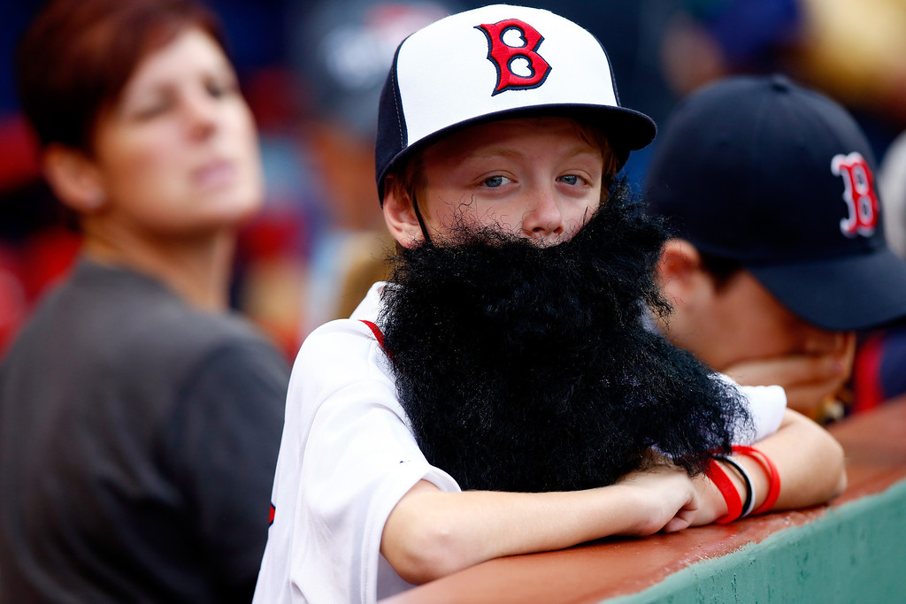 . A young fan looks on during batting practice before Game Two of the American League Division Series between the Boston Red Sox and the Tampa Bay Rays at Fenway Park on October 5, 2013 in Boston, Massachusetts.  (Photo by Jared Wickerham/Getty Images)