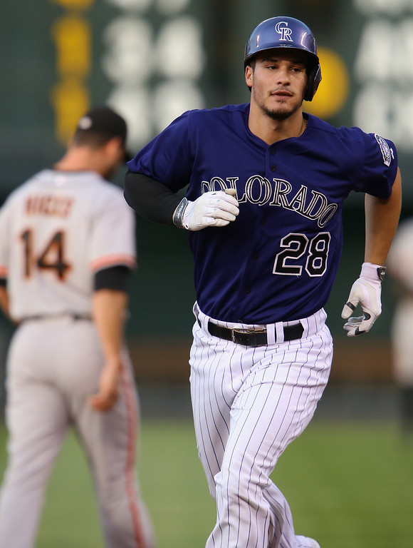 . Nolan Arenado #28 of the Colorado Rockies rounds the bases on his solo homerun off of starting pitcher Ryan Vogelsong #32 of the San Francisco Giants to take a 1-0 lead in the first inning at Coors Field on April 21, 2014 in Denver, Colorado.  (Photo by Doug Pensinger/Getty Images)