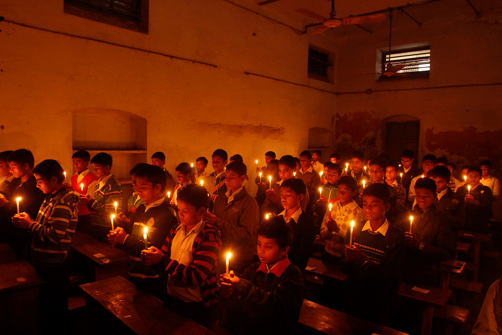 . Indian students light candles to pay tribute to legendary Indian sitar player Ravi Shankar at the Bengali Tola Inter College where Shankar had studied in Varanasi,  India, Wednesday, Dec. 12, 2012. Shankar, who is credited with connecting the world to Indian music, died Tuesday in San Diego at the age of 92. (AP Photo/Rajesh Kumar Singh)