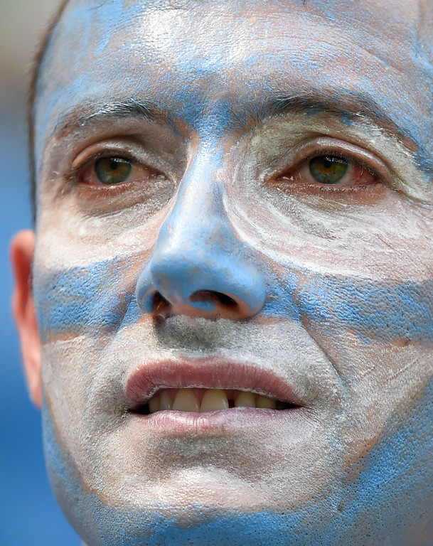 . A football fan is pictured before the start of a Group D match between Italy and Costa Rica at the Pernambuco Arena in Recife during the 2014 FIFA World Cup on June 20, 2014.   AFP PHOTO / EMMANUEL DUNAND/AFP/Getty Images