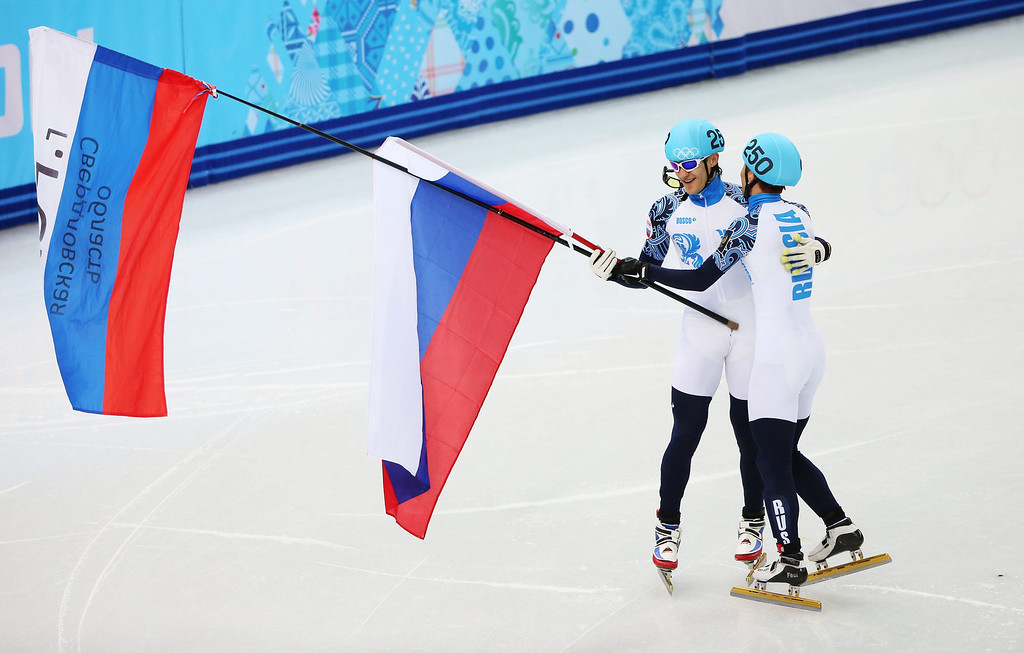 . Victor An (R) and Vladimir Grigorev of Russia celebrate after placing first and second respectively in men\'s 1000m at the Short Track events in the Iceberg Skating Palace at the Sochi 2014 Olympic Games, Sochi, Russia, 15 February 2014.  EPA/HANNIBAL HANSCHKE