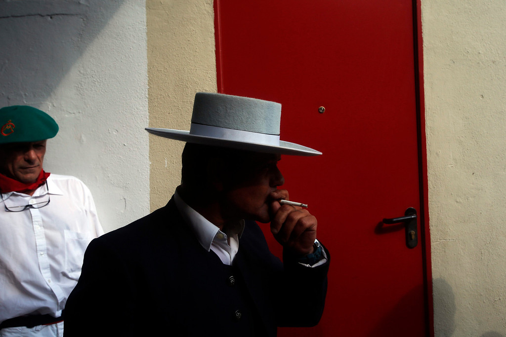 """. The \""""mayoral\"""" (head of the bull herders) smokes a cigarette before the fifth bullfight of the San Fermin festival in Pamplona July 11, 2013. REUTERS/Susana Vera"""