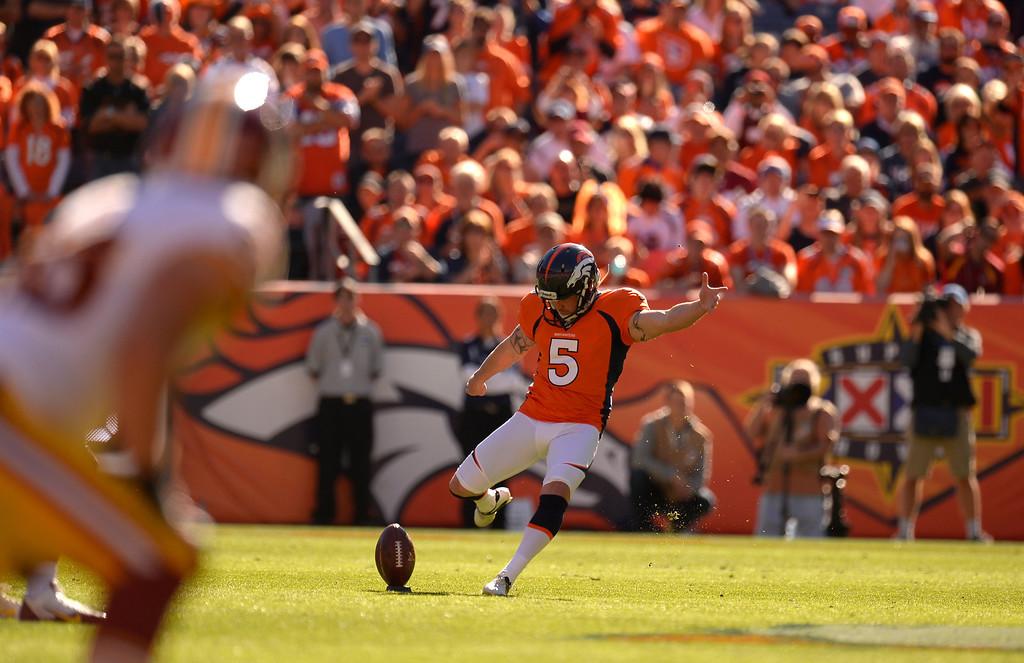 . DENVER, CO - OCTOBER 27: Denver Broncos kicker Matt Prater (5) kicks off after the Broncos scored in the first quarter. The Denver Broncos take on the Washington Redskins at Sports Authority Field at Mile High in Denver on October 27, 2013. (Photo by John Leyba/The Denver Post)