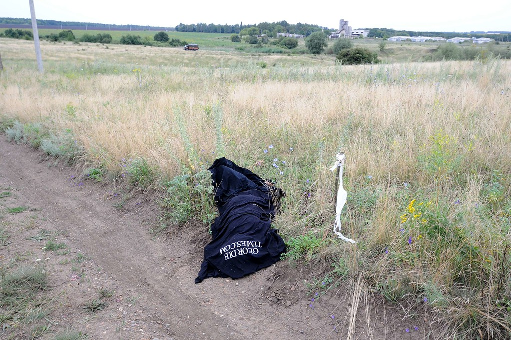 . A picture taken on July 18, 2014 shows a body covered by a blanket on the site of the crash of the Malaysia Airlines jet carrying 298 people from Amsterdam to Kuala Lumpur a day after it crashed, near the town of Shaktarsk, in rebel-held east Ukraine. Pro-Russian rebels fighting central Kiev authorities claimed on July 17 that the Malaysian airline that crashed in Ukraine had been shot down by a Ukrainian jet. All 298 people on board Flight MH17 died when the plane crashed. AFP PHOTO /DOMINIQUE FAGET/AFP/Getty Images