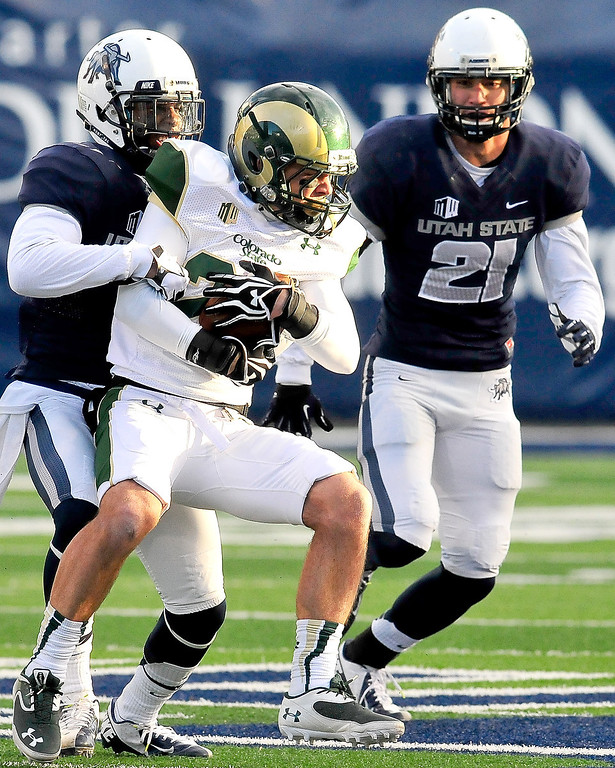 . Utah State\'s Rashard Stewart, left, tackles Colorado State\'s Davon Riddick during an NCAA college football game, Saturday, Nov. 23, 2013, in Logan, Utah. Utah State won 13-0. (AP Photo/Herald Journal, John Zsiray)