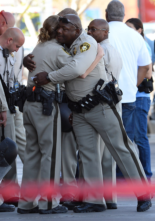 . Las Vegas  Metropolitan Police Department officers hug near a Wal-Mart on June 8, 2014 in Las Vegas, Nevada.   (Photo by Ethan Miller/Getty Images)