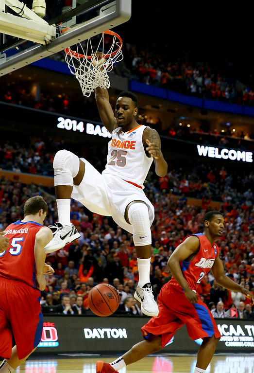 . BUFFALO, NY - MARCH 22: Rakeem Christmas #25 of the Syracuse Orange dunks against the Dayton Flyers during the third round of the 2014 NCAA Men\'s Basketball Tournament at the First Niagara Center on March 22, 2014 in Buffalo, New York.  (Photo by Elsa/Getty Images)