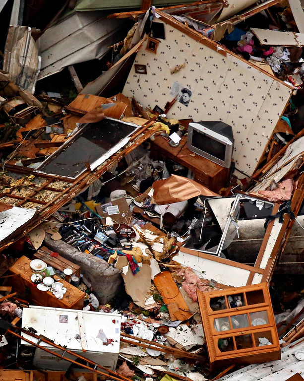 . This aerial photo shows the contents of home\'s living area damaged caused by Wednesday\'s tornado in Granbury, Texas on Thursday, May 16, 2013. (AP Photo/The Dallas Morning News, G.J.McCarthy)
