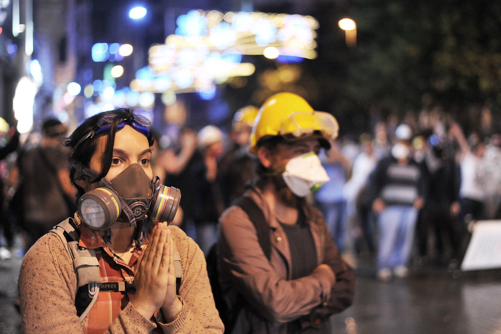 . A woman begs riot police not to use tear gas at Istiklal street near Taksim square in Istanbul, on June 15, 2013.  Police fired tear gas and jets of water to disperse hundreds of demonstrators in Istanbul\'s Taksim Square, shortly after Turkish Prime Minister Recep Tayyip Erdogan warned police would intervene to end protesters\' occupation of a park bordering the square. Turkish protesters today had refused to budge from an Istanbul park at the centre of nationwide anti-government demonstrations after rejecting a government olive branch aimed at ending two weeks of deadly unrest.  OZAN KOSE/AFP/Getty Images