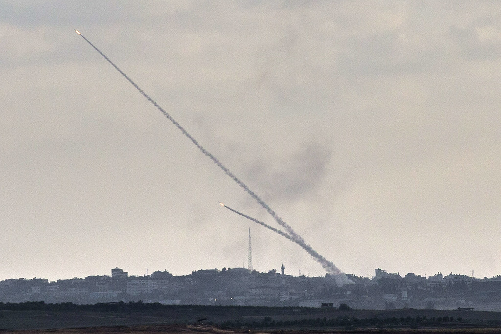 . A picture taken from the southern Israeli city of Sderot shows rockets being launched from the Gaza Strip into Israel, on July 15, 2014. Prime Minister Benjamin Netanyahu pledged today to ramp up Israel\'s military campaign against Gaza, after an Egyptian truce plan failed to end eight days of cross-border fire. AFP PHOTO / JACK  GUEZ/AFP/Getty Images