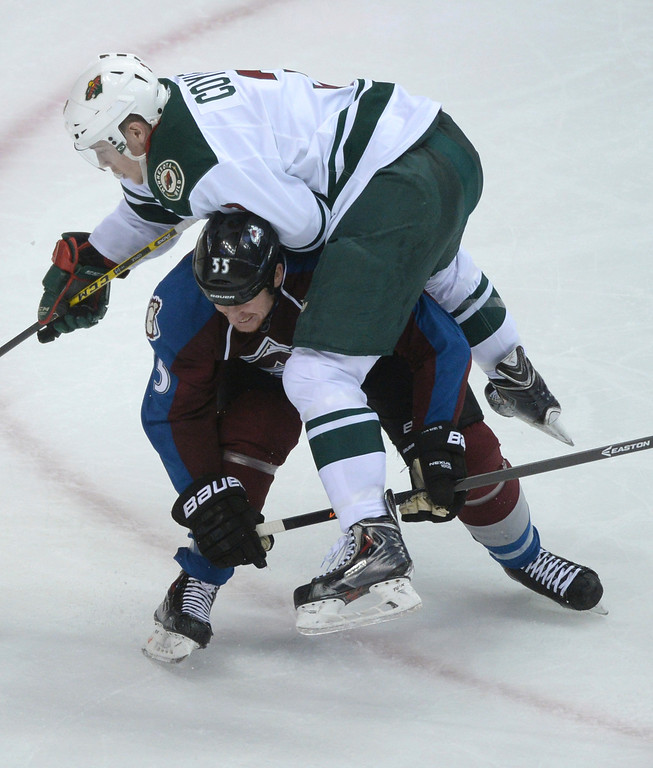 . DENVER, CO - APRIL 24: Minnesota center Charlie Coyle climbed atop Colorado wing Cody McLeod in the second period. Coyle was given a two minute penalty for roughing. The Colorado Avalanche hosted the Minnesota Wild in the fifth game of a playoff series Saturday night, April 26, 2014. (Photo by Karl Gehring/The Denver Post)