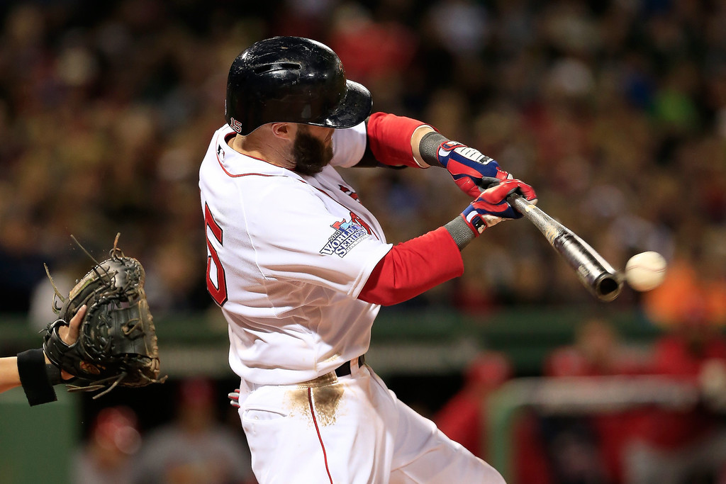. Dustin Pedroia #15 of the Boston Red Sox hits a single against the St. Louis Cardinals in the first inning of Game One of the 2013 World Series at Fenway Park on October 23, 2013 in Boston, Massachusetts.  (Photo by Jamie Squire/Getty Images)