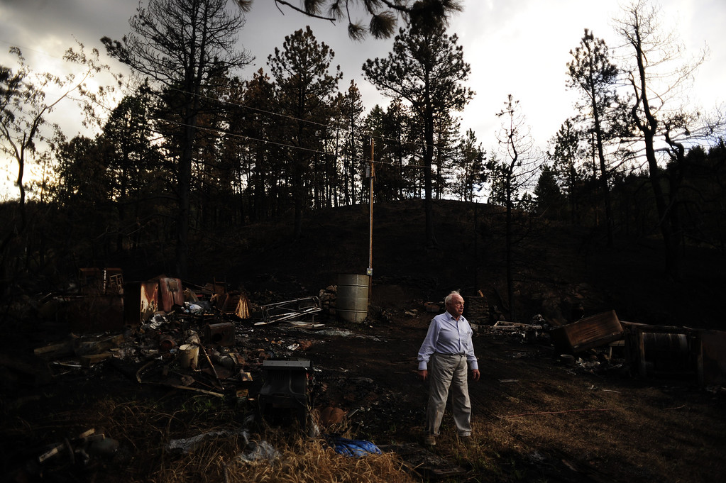 . Gyorgy Vidacs looks through the remains of his home burned by the High Park Fire after he and other residents were allowed back into their properties on Rist Canyon Road on Thursday, June 28, 2012. AAron Ontiveroz, The Denver Post