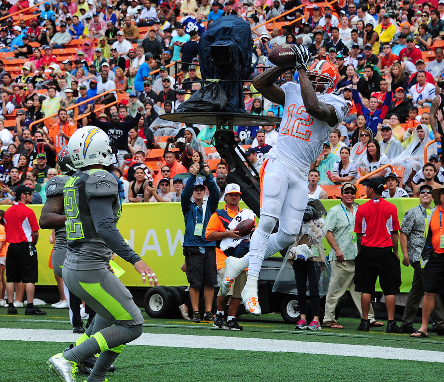 . Josh Gordon #12 of the Cleveland Browns and Team Rice makes a catch for a touchdown against Team Sanders during the 2014 Pro Bowl at Aloha Stadium on January 26, 2014 in Honolulu, Hawaii  (Photo by Scott Cunningham/Getty Images)