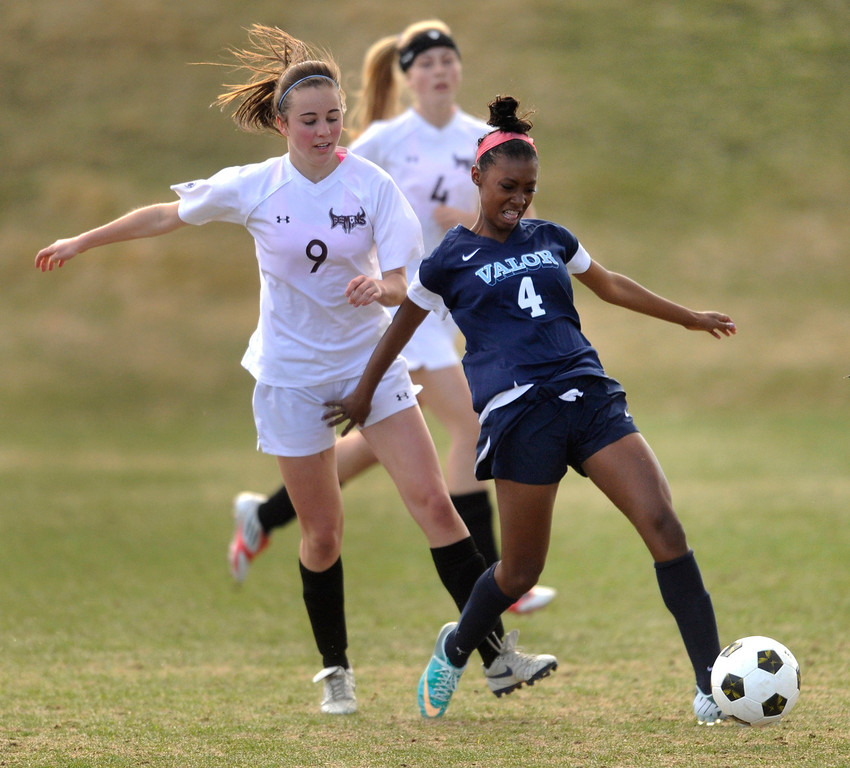 . PARKER, CO. - APRIL 2: Eagles forward Cydney Billups (4) advanced the ball in the first half. The Valor Christian High School girl\'s soccer team defeated Golden 4-1 Wednesday night, April 3, 2013.  Photo By Karl Gehring/The Denver Post)