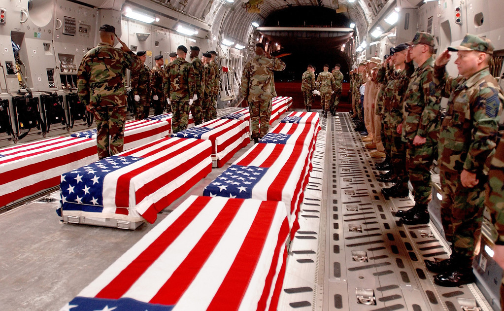 . Coffins of U.S. military personnel are prepared to be offloaded at Dover Air Force Base in Dover, Delaware in this undated photo. The U.S. Air Force, in response to a Freedom of Information Act request, released to Web site  www.thememoryhold.org on April 14 more than 300 photographs showing the remains of U.S. service members returning home. The Pentagon tightly restricted publication of photographs of coffins with the remains of U.S. troops and had forbidden journalists from taking pictures at Dover Air Force Base in Delaware, the first stop for the bodies of troops being sent home. REUTERS/USAF