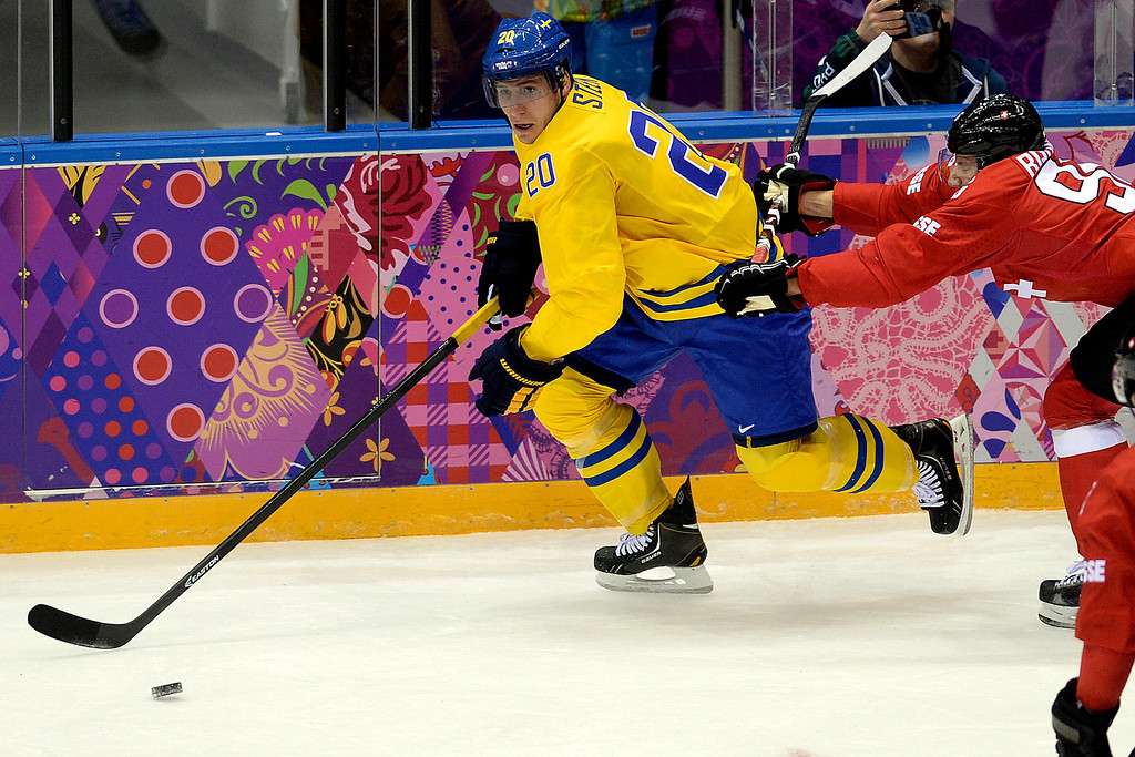. Switzerland\'s Roman Josi tries to check Sweden\'s Alexander Steen during the action at Bolshoy Arena. Sochi 2014 Winter Olympics on Friday, February 14, 2014. (Photo by AAron Ontiveroz/The Denver Post)