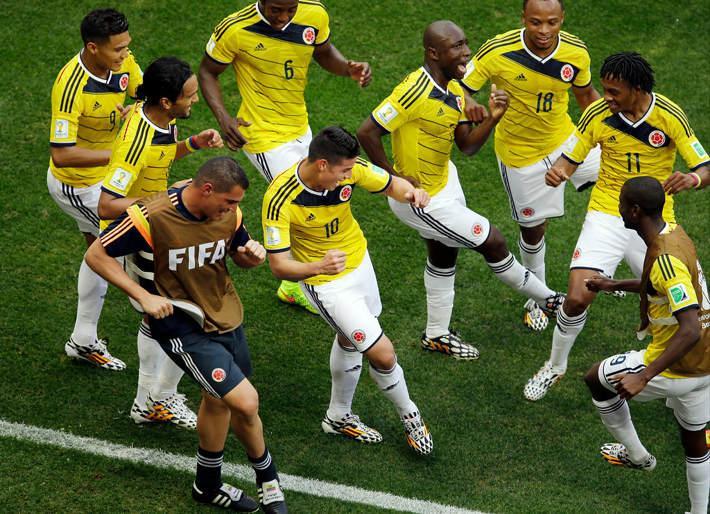 . Colombia\'s James Rodriguez, center, dances with teammates in celebration after scoring during the group C World Cup soccer match between Colombia and Ivory Coast at the Estadio Nacional in Brasilia, Brazil, Thursday, June 19, 2014.  (AP Photo/Themba Hadebe)
