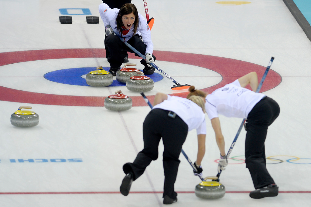 . Great Britain skip Eve Muirhead instructs teammates during a women\'s curling qualifier against Canada at the Ice Cube Curling Center. Sochi 2014 Winter Olympics on Wednesday, February 12, 2014. (Photo by AAron Ontiveroz/The Denver Post)