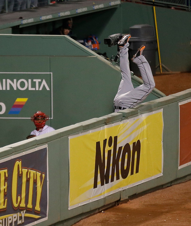 . Detroit Tigers\' Torii Hunter leaps and misses a catch as Boston Red Sox\'s David Ortiz hits a grand slam home run in the eighth inning during Game 2 of the American League baseball championship series Sunday, Oct. 13, 2013, in Boston. (AP Photo/Charlie Riedel)