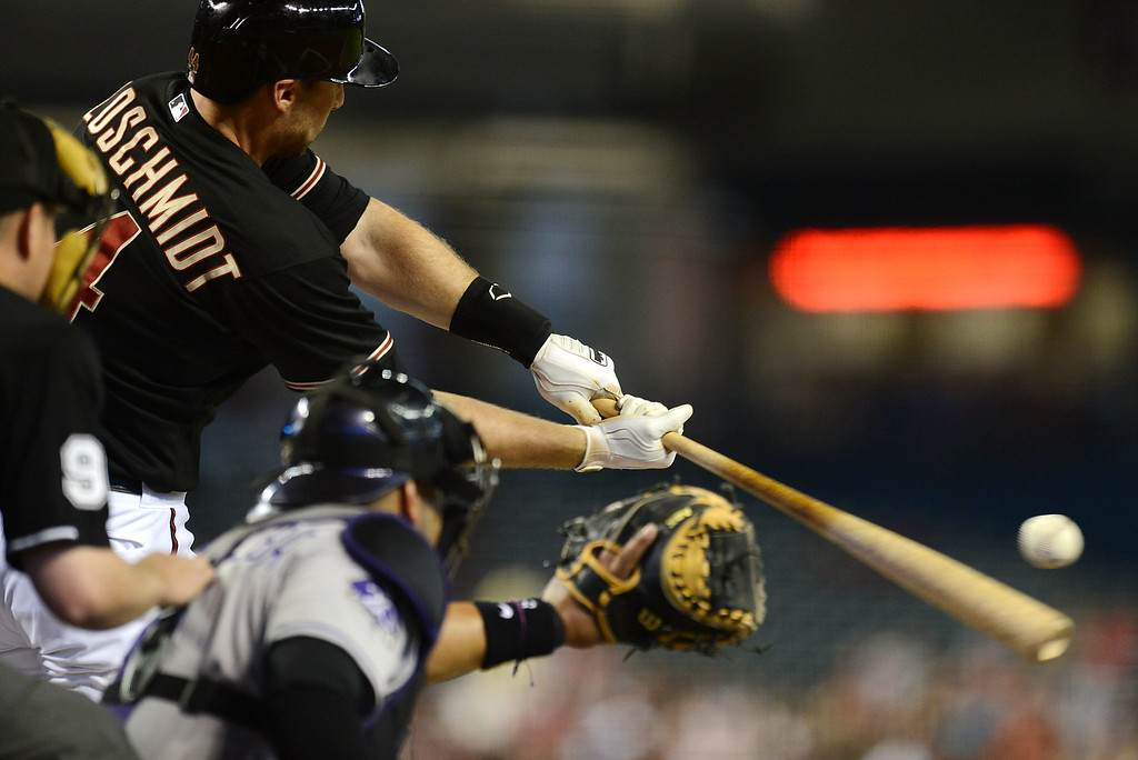 . PHOENIX, AZ - JULY 06:  Paul Goldschmidt #44 of the Arizona Diamondbacks drives the ball into the outfield against the Colorado Rockies at Chase Field on July 6, 2013 in Phoenix, Arizona.  (Photo by Norm Hall/Getty Images)
