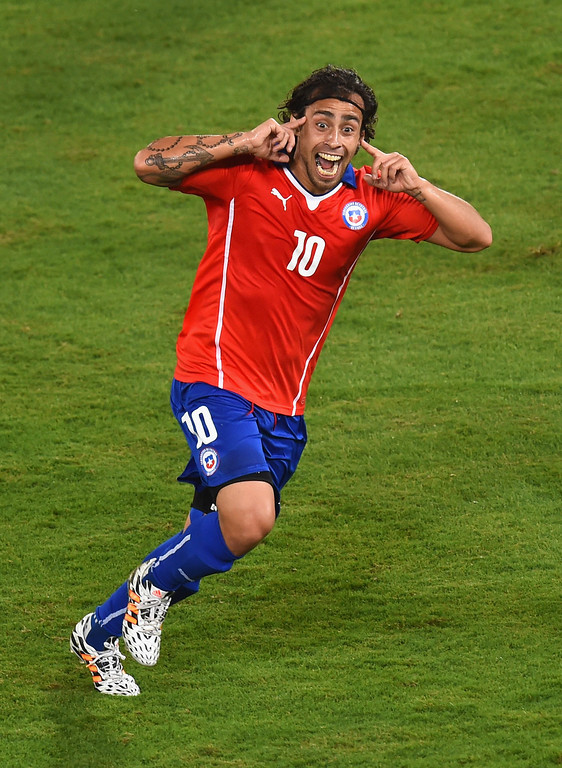 . Jorge Valdivia of Chile celebrates after scoring the teams second goal during the 2014 FIFA World Cup Brazil Group B match between Chile and Australia at Arena Pantanal on June 13, 2014 in Cuiaba, Brazil.  (Photo by Stu Forster/Getty Images)