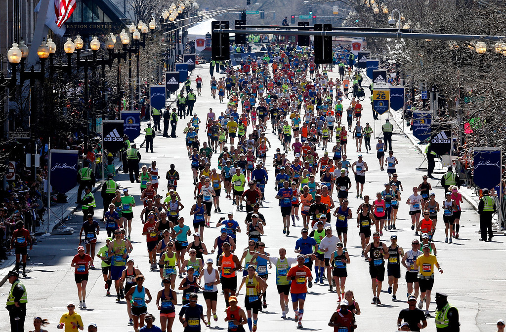 . Runners approach the finish line of the 118th Boston Marathon on April 21, 2014 in Boston, Massachusetts.  (Photo by Jim Rogash/Getty Images)