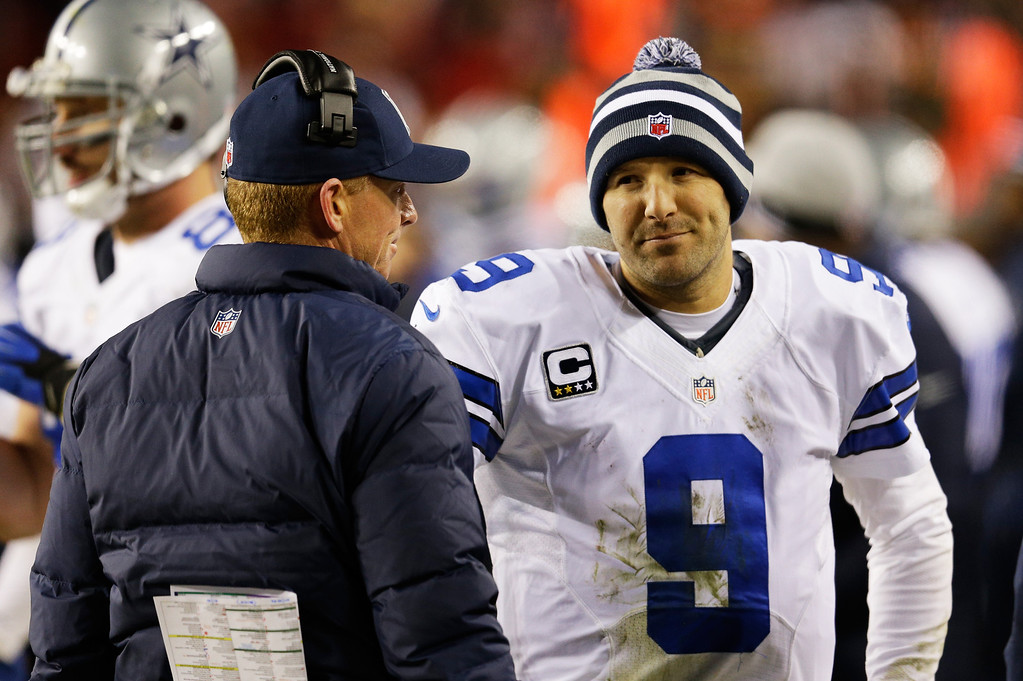 . LANDOVER, MD - DECEMBER 30:  Head coach Jason Garrett talks to Tony Romo #9 of the Dallas Cowboys after they failed to convert on a third down against the Washington Redskins at FedExField on December 30, 2012 in Landover, Maryland.  (Photo by Rob Carr/Getty Images)