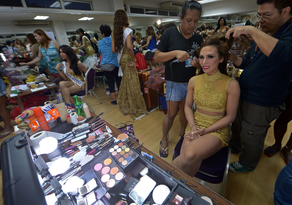 . Contestants get decorate her hair at backstage during the Miss International Queen 2013 beauty contest in Pattaya resort on November 1, 2013. Twenty-five contestants from 17 countries are to compete in Pattaya for the crown of Miss International Queen since 2004. AFP PHOTO / PORNCHAI  KITTIWONGSAKUL/AFP/Getty Images