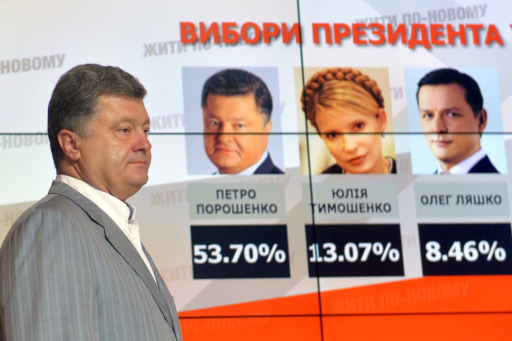 ". Presidential candidate Petro Poroshenko walks in front of screen displaying results of the presidential elections in Ukraine prior his press-conference in Kiev on May 26, 2014. Billionaire Petro Poroshenko said Monday after claiming victory in Ukraine\'s presidential election that he wanted to continue the military offensive in the separatist east but also to make it more ""efficient\"". \""I support continuing the operation, but I demand that its format be changed,\"" Poroshenko told reporters a day after Ukraine\'s presidential vote. \""It must be shorter in terms of time-frames and more efficient\"".   SERGEI SUPINSKY/AFP/Getty Images"