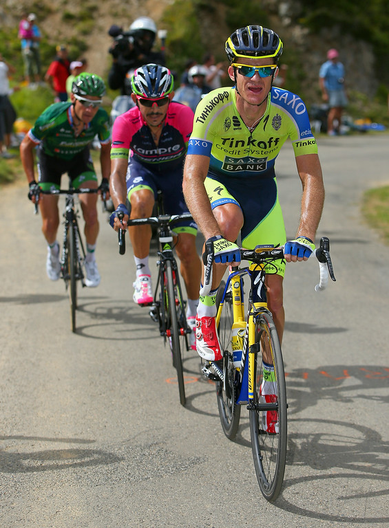 . Michael Rogers of Australia and Tinkoff-Saxo leads Jose Rodolfo Serpa of Columbia and Lampre-Merida and Thomas Voeckler of France and Team Europcar on the climb of the Port de Bales as Rogers went on to win the sixteenth stage of the 2014 Tour de France, a 238km stage between Carcassonne and Bagneres-de-Luchon, on July 22, 2014 in Bourg d\'Oueil, France.  (Photo by Doug Pensinger/Getty Images)