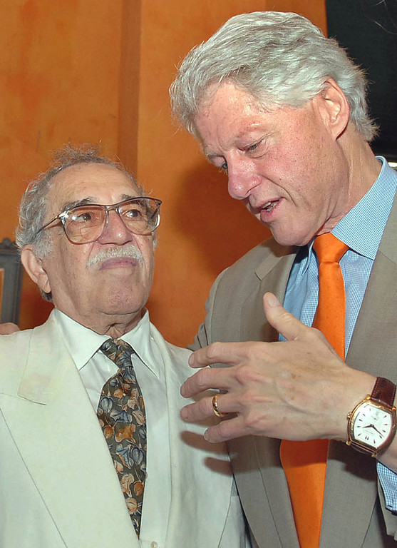. In this March 26, 2007 file photo released by Colombia\'s News Service SNE, former U.S. President Bill Clinton, right, speaks with Colombian Nobel laureate Gabriel Garcia Marquez at the opening ceremony of International Congress of Spanish Language in Cartagena, Colombia. Marquez died Thursday April 17, 2014 at his home in Mexico City. (AP Photo/Cesar Carrion, SNE)