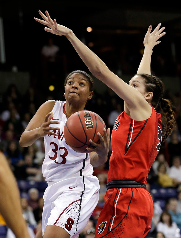 . Stanford\'s Amber Orrange (33) drives against Georgia\'s Anne Marie Armstrong in the first half of a regional semifinal game in the NCAA women\'s college basketball tournament Saturday, March 30, 2013, in Spokane, Wash. (AP Photo/Elaine Thompson)