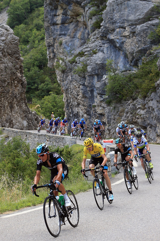 . Chris Froome of Great Britain riding for Sky Procycling defends the overall race leader\'s yellow jersey as the peloton passes through the Gorges de la Meouge during stage sixteen of the 2013 Tour de France, a 168KM road stage from Vaison-la-Romaine to Gap, on July 16, 2013 in Chateau Neuf de Chabre, France.  (Photo by Doug Pensinger/Getty Images)