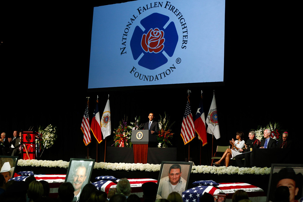 . President Barack Obama and first lady Michelle Obama attend the memorial for firefighters killed at the fertilizer plant explosion in West, Texas, at Baylor University in Waco, Texas, Thursday, April 25, 2013. (AP Photo/Charles Dharapak)