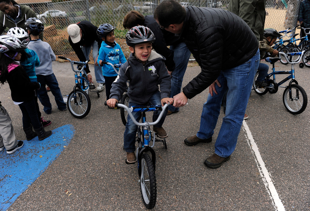 . DENVER, CO - Oct. 11: Kindergartener Adam Urquidi, 6, is ready to go after getting his new bike and helmet. Wish for Wheels and its volunteers build and give away over one hundred bikes to kindergarteners and first-graders at Smith Renaissance School in Park Hill. Wish for Wheels says its goal with one-in-five children liven in poverty, is to give as many kids as possible their first brand new bike and helmet. (Photo By Kathryn Scott Osler/The Denver Post)