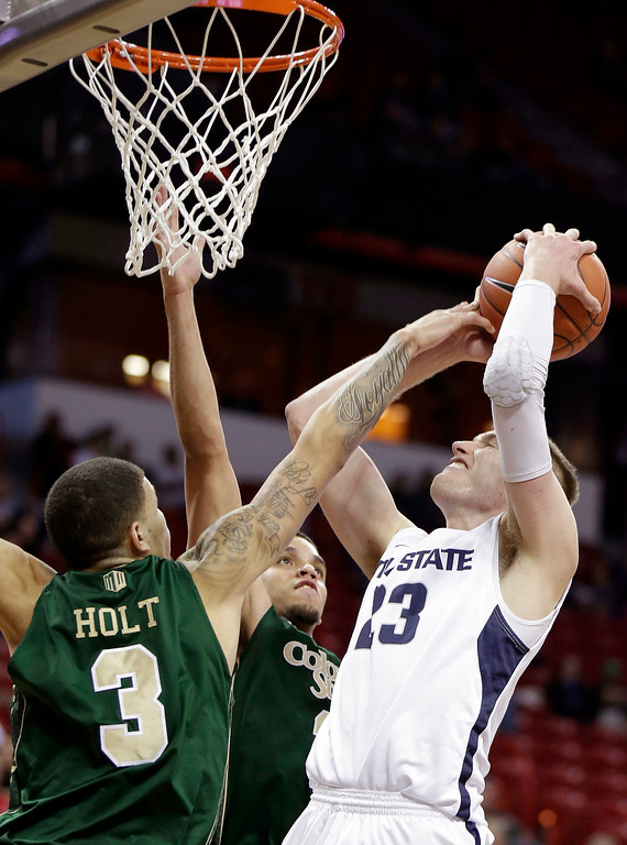 . Utah State\'s Kyle Davis shoots over Colorado State\'s Marcus Holt during the second half of a Mountain West Conference tournament NCAA college basketball game Wednesday, March 12, 2014, in Las Vegas. Utah State defeated Colorado State 73-69. (AP Photo/Isaac Brekken)