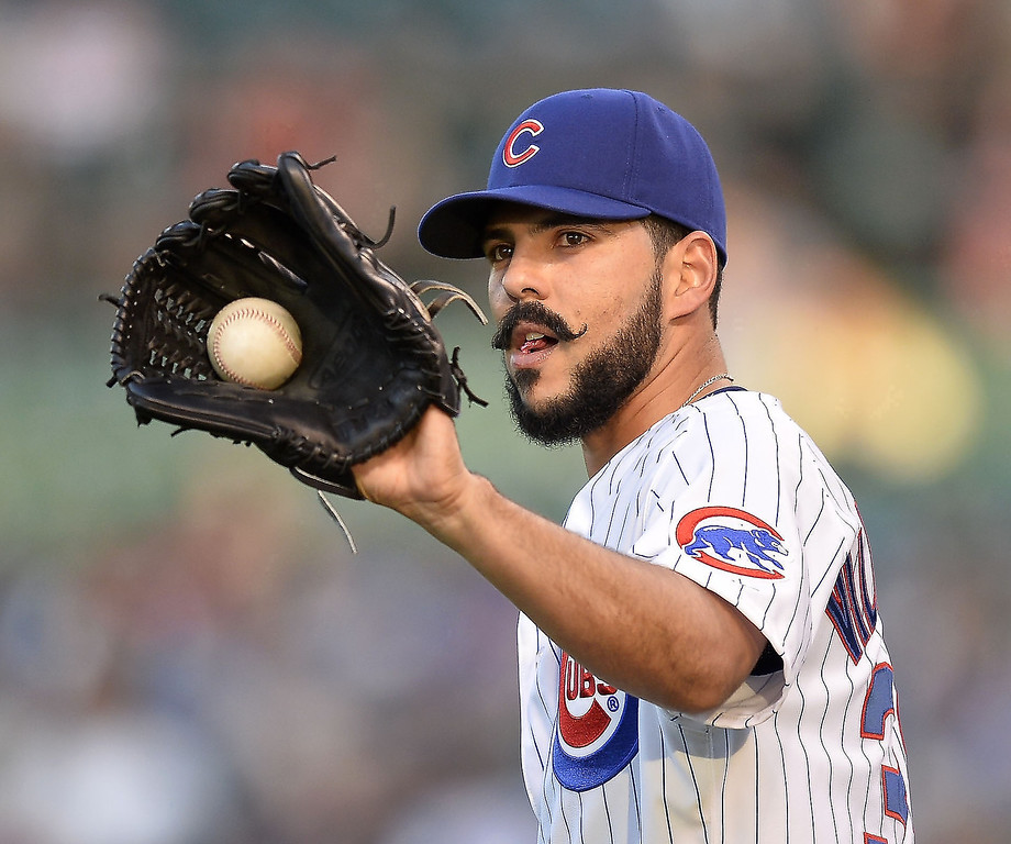 . Starting pitcher Carlos Villanueva #33 of the Chicago Cubs gets the ball back during the first inning against the Colorado Rockies on May 14, 2013 at Wrigley Field in Chicago, Illinois.    (Photo by Brian Kersey/Getty Images)