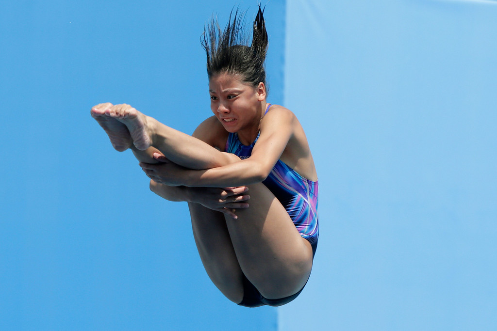 . Sharon Chan of Hong Kong competes in the Women\'s 1m Springboard Diving preliminary round on day two of the 15th FINA World Championships at Piscina Municipal de Montjuic on July 21, 2013 in Barcelona, Spain.  (Photo by Adam Pretty/Getty Images)